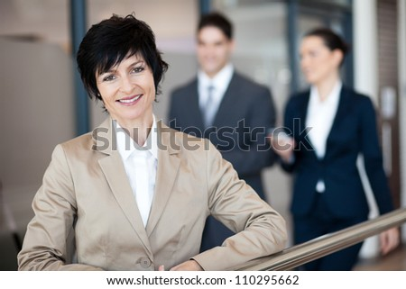 middle aged businesswoman portrait outside office - stock photo