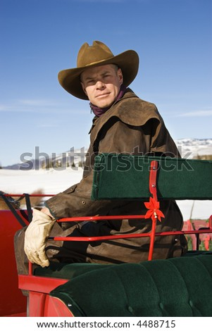 Middle-aged Caucasian male sitting in a sleigh.