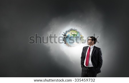 Middle aged confident businessman holding his hands in pockets. Elements of this image are furnished by NASA