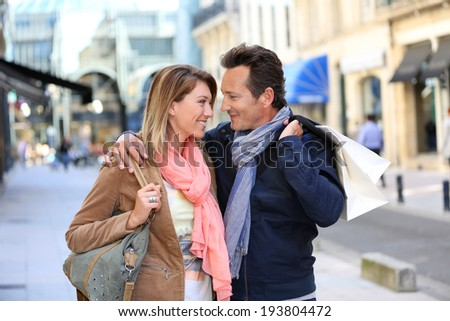 Middle-aged couple doing shopping on week-end - stock photo