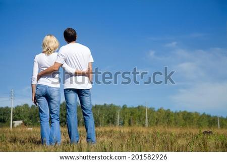 middle aged couple enjoying life together on nature - stock photo