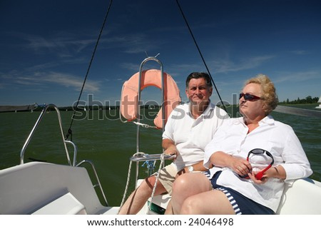 middle-aged couple on boat sailing