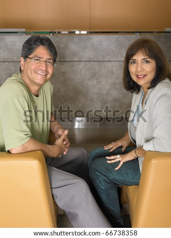 Middle-aged couple smiling for the camera - stock photo