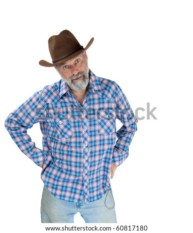 Middle aged cowboy standing with hands on hips