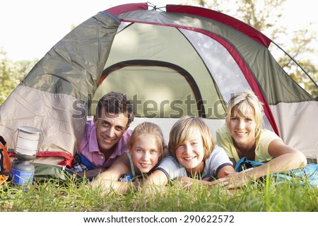 Middle Aged Family On Camping Holiday In Countryside