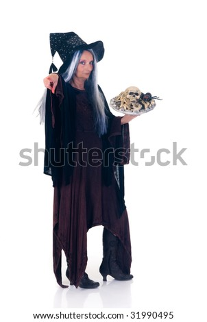 Middle aged Halloween witch  Studio, white background.