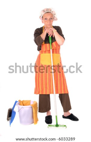 Middle aged housewife with curlers in hair and net on head, wearing colorful apron.  house cleaning utensils on the side. - stock photo