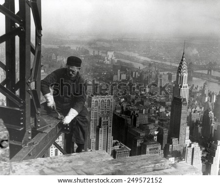 Middle aged iron worker at the Empire State Building construction site, 1930. The Chrysler Building's spire is at right. Photo By Lewis Hine. - stock photo
