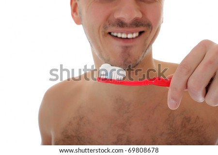 Middle aged man brushing his teeth in the morning. isolated on white background - stock photo