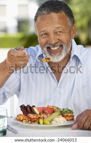 Middle Aged Man Dining Al Fresco - stock photo