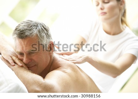 Middle Aged Man Enjoying Massage - stock photo