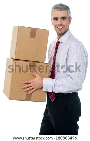 Middle aged man holding stack of parcel boxes - stock photo