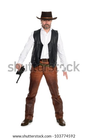 Middle aged man in a cowboy hat with a gun. - stock photo