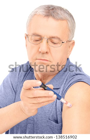 Middle aged man injecting insulin in his arm, isolated on white background - stock photo