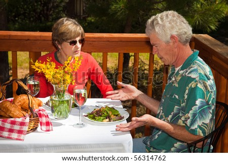 MIddle Aged Man not Happy with the Salad he Got Served at an Outdoor Cafe. - stock photo
