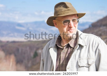 Middle aged man outdoor, looking concerned. - stock photo