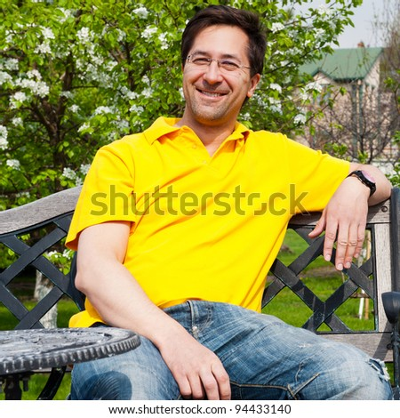 Middle Aged Man Relaxing In Garden