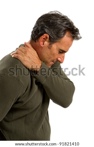 Middle aged man rubs his shoulder to relieve the painful muscles.