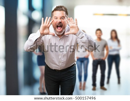 middle aged man shouting