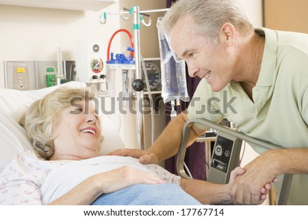 Middle Aged Man Visiting His Mother In Hospital - stock photo