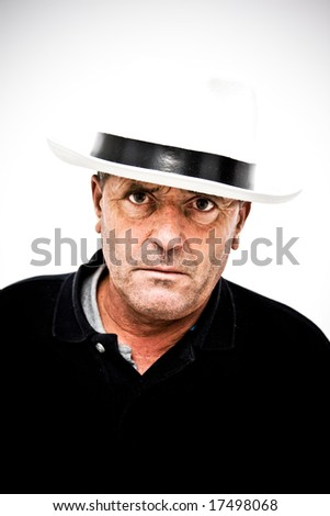 Middle aged man with a gangster look.