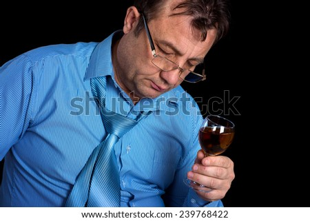 Middle-aged man (45-50) with a glass of wine. Isolated. - stock photo
