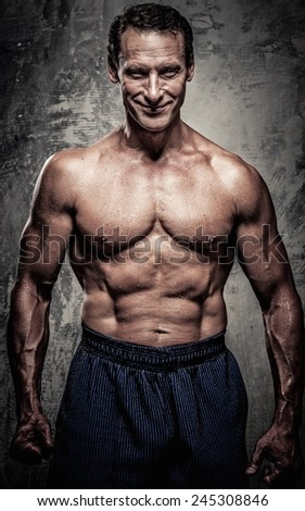 Middle-aged man with muscular body - stock photo