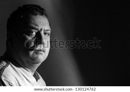middle-aged man with mustache, black and whiye - stock photo