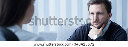 Middle aged man with problem listening to psychotherapist