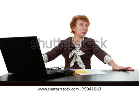 middle-aged woman at a computer on a white background