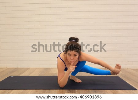 Middle-aged woman doing Yoga at studio.Yoga help look young .