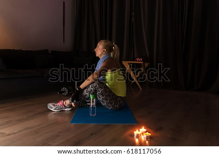 Middle aged woman doing yoga meditation at home