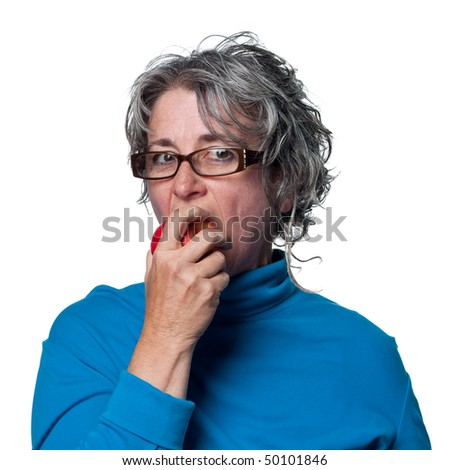 Middle aged woman eating a fresh organic apple - stock photo