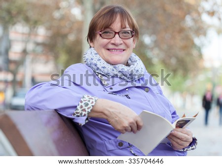 Middle-aged woman  in autumn   park  - stock photo