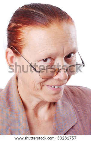 Middle aged woman is holding her glasses and smiling