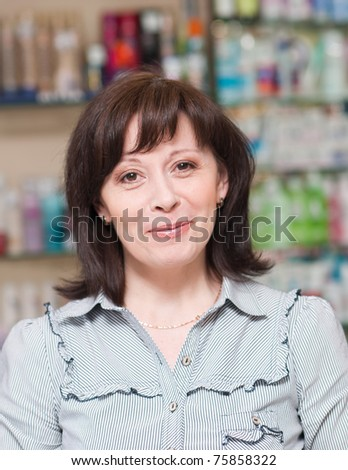 middle-aged woman looks thoughtfully - stock photo