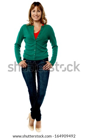 Middle aged woman posing in trendy style - stock photo
