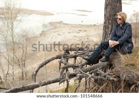 middle aged woman relaxing in the forest - stock photo