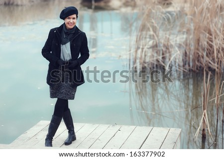 Middle aged woman walking in autumn park