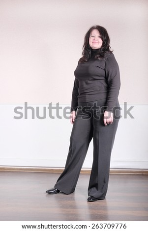 Middle aged woman with black blouse. Full length posing - stock photo
