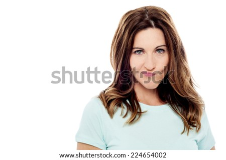 Middle aged woman with weird expression, isolated on white - stock photo