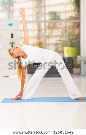 middle aged woman workout at home - stock photo