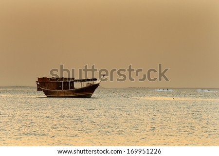 Middle East: The traditional sail boat is called the Dhow. These are individually hand crafted boats made entirely of timber - stock photo
