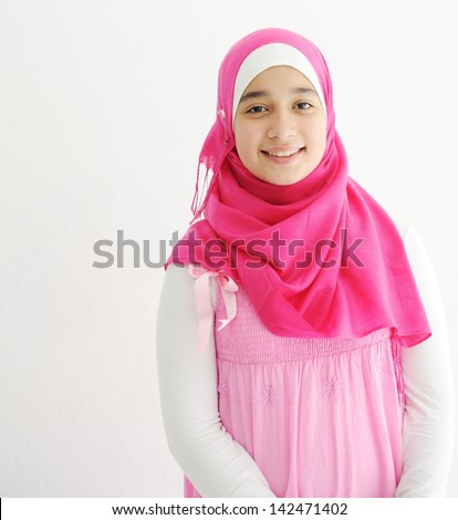 Middle eastern Arabic girl wearing pink hijab scarf on white - stock photo