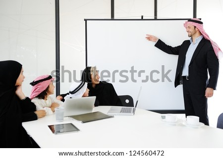 Middle eastern business people with children at office - stock photo