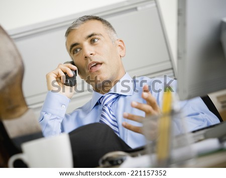 Middle Eastern businessman talking on telephone - stock photo