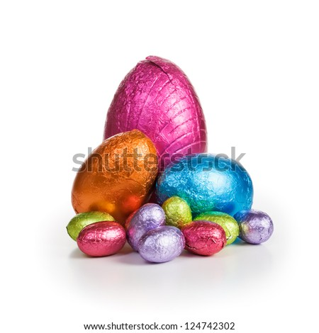 Middle group of chocolate candy Easter eggs wrapped in foil - stock photo