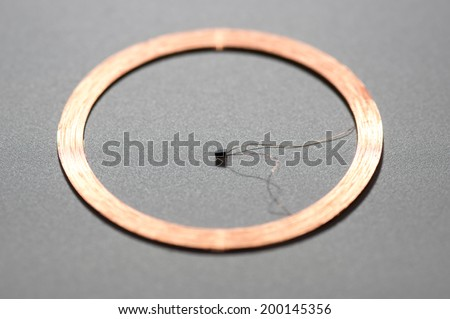 middle RFID Antenna copper coil gray Background - stock photo