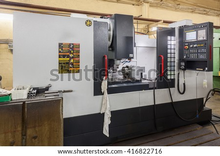 Middle size CNC milling machine. Outside view of workplace. - stock photo