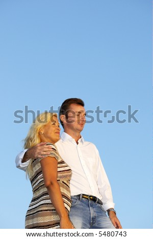 Middleage couple looking a sunset